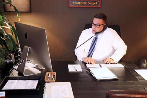 Matthew Siegel at desk